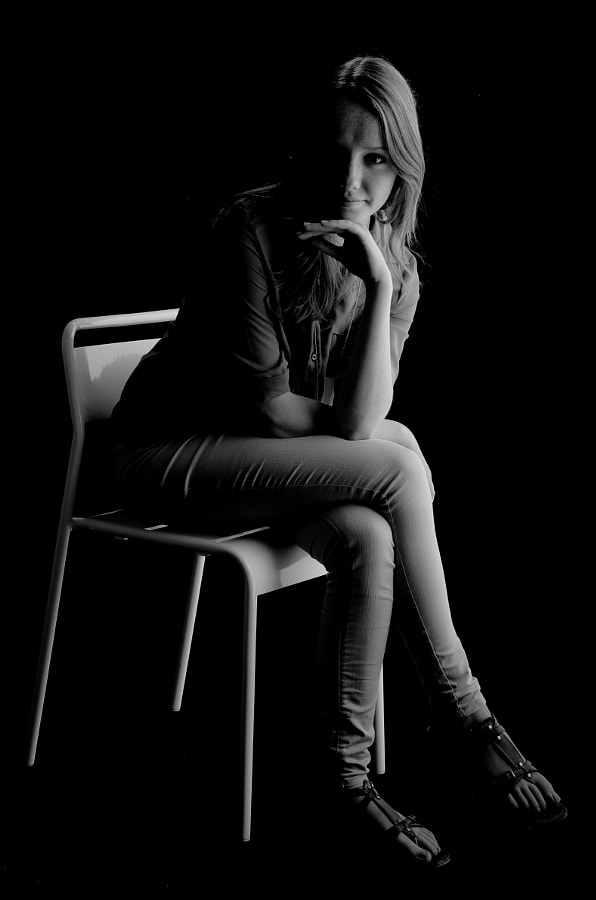 A girl on a chair