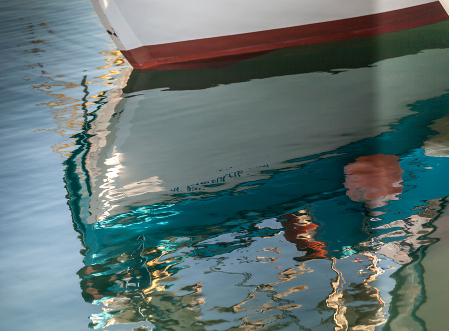 Water Reflexions Under Boat