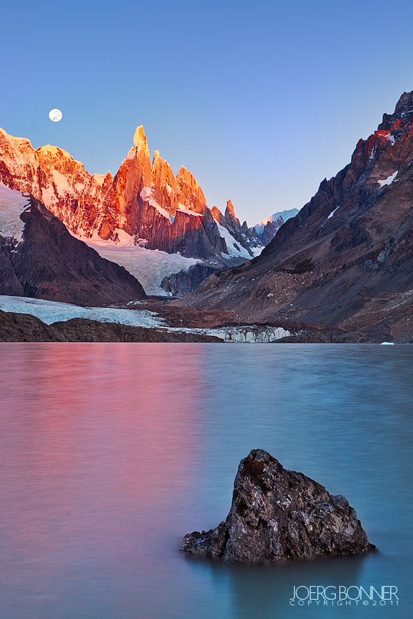 Photograph Cerro Torre with Full Moon at Sunrise by Joerg Bonner on 500px