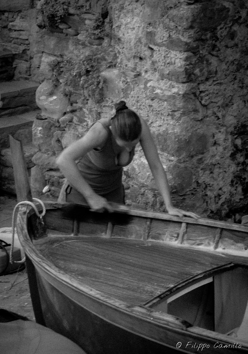 Photograph A woman is caring about her boat by Filippo Camillo on 500px