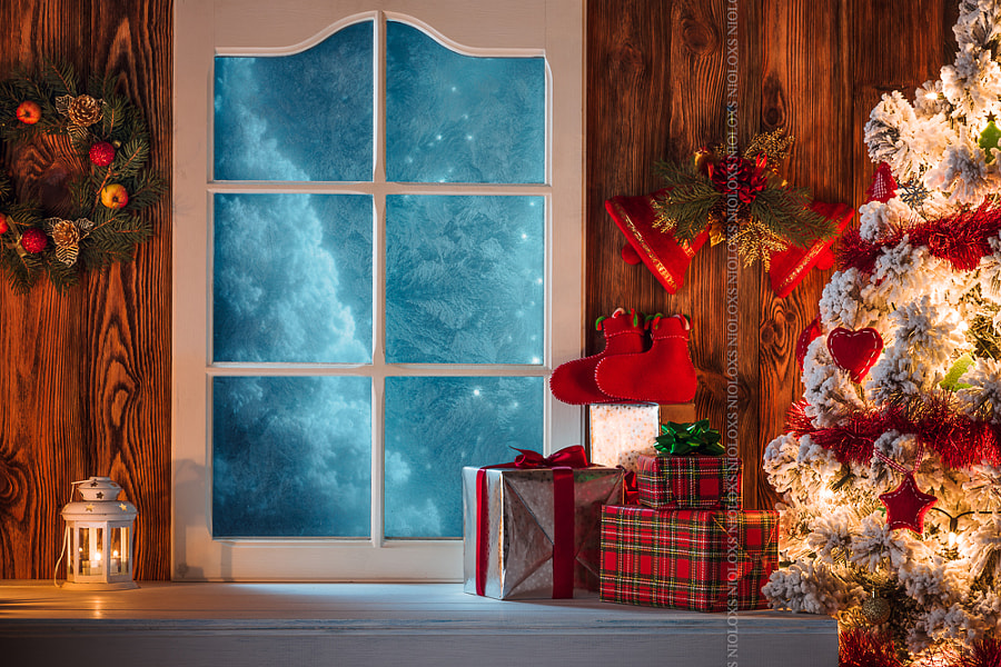 Christmas scene with tree gifts and frozen window in background by Kamil Zabłocki on 500px.com