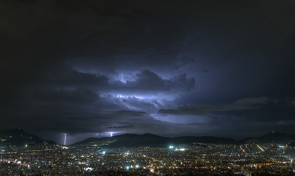 Photograph Lightning over town. by Chris Kaddas on 500px