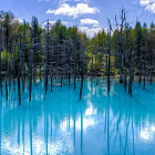 It's an artificial pond created by accident when a dam was erected to protect the region from mudflows that might occur from the nearby volcano on mountain.