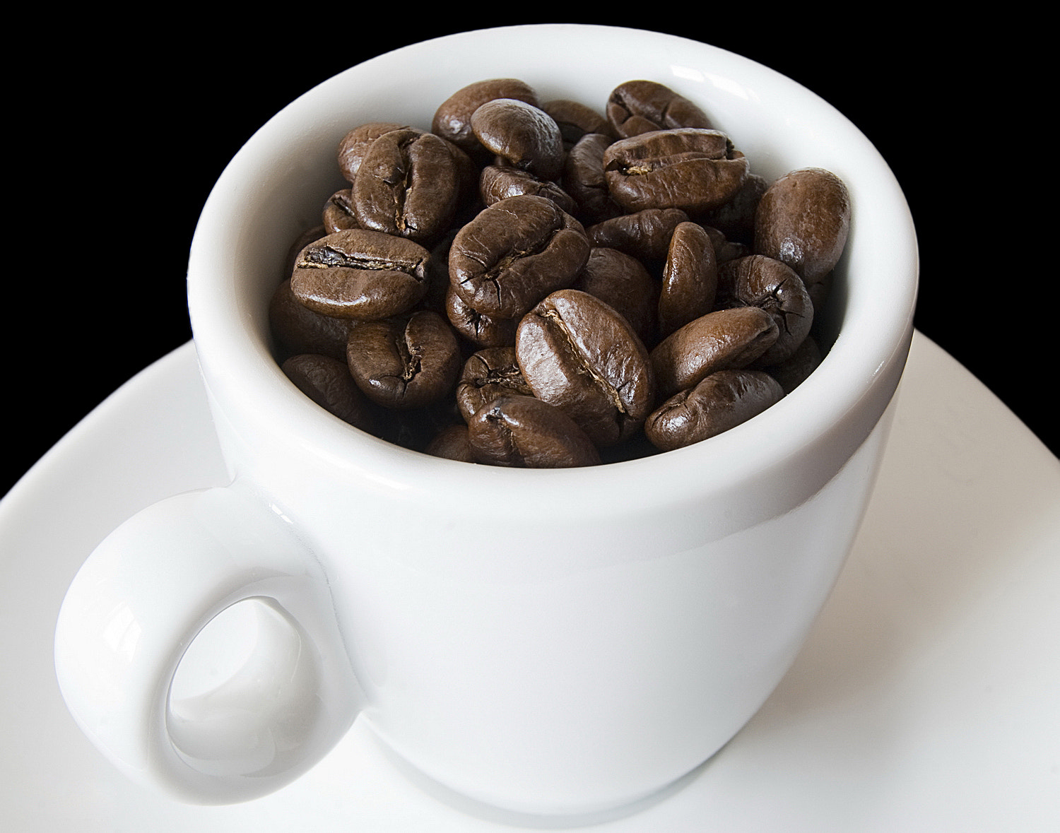 Grains of coffee in white cup