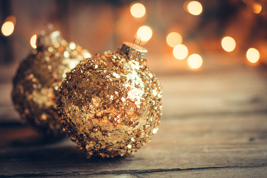 Golden christmas ornaments on rustic background by Alena Haurylik on 500px.com