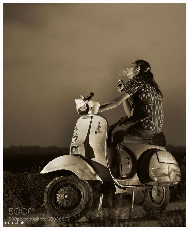 Photograph The Scooterist by Razali Ahmad on 500px