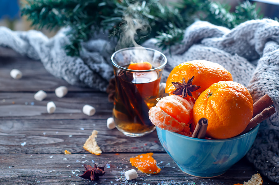 Tangerine in scarf over wooden background by Yuliia Mazurkevych on 500px.com