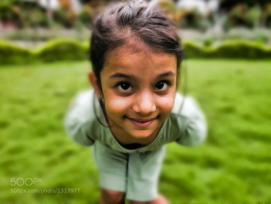 a photo of a girl peeking into the camera lens