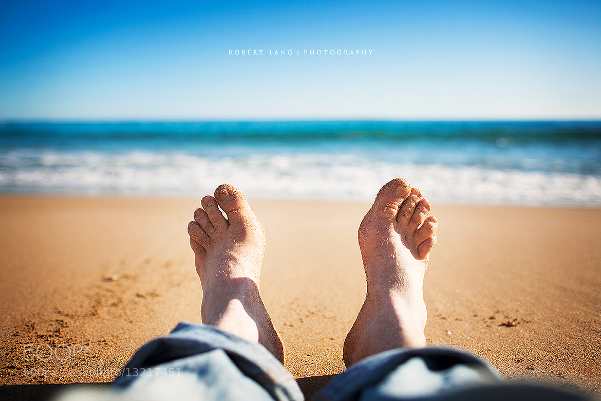 Photograph Laying down, two feet on a sandy beach, Australia by Robert Lang on 500px