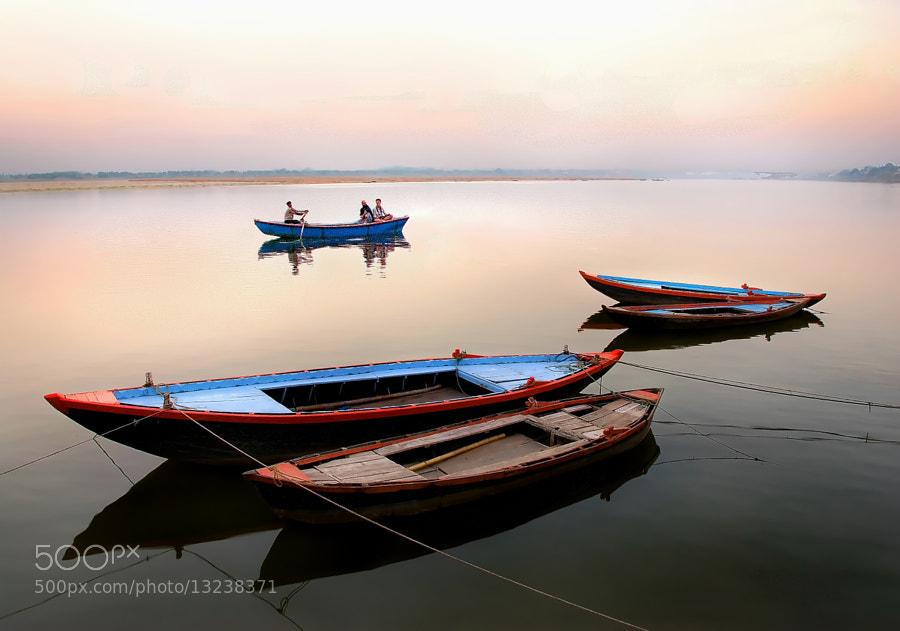 Varanasi, Uttar Pradesh, India.  Ganges River and boats at sunset.