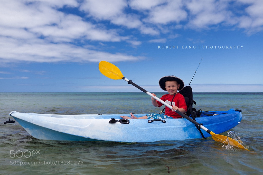 Photograph Child in kayak, Australia by Robert Lang on 500px