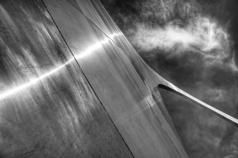 Not alien although an interesting combination of light, reflections and clouds.  This is a near vertical shot of sunlight reflecting off the outer skin of the Gateway Arch in St. Louis, MO USA  The passing cloud overhead made it rather surreal.