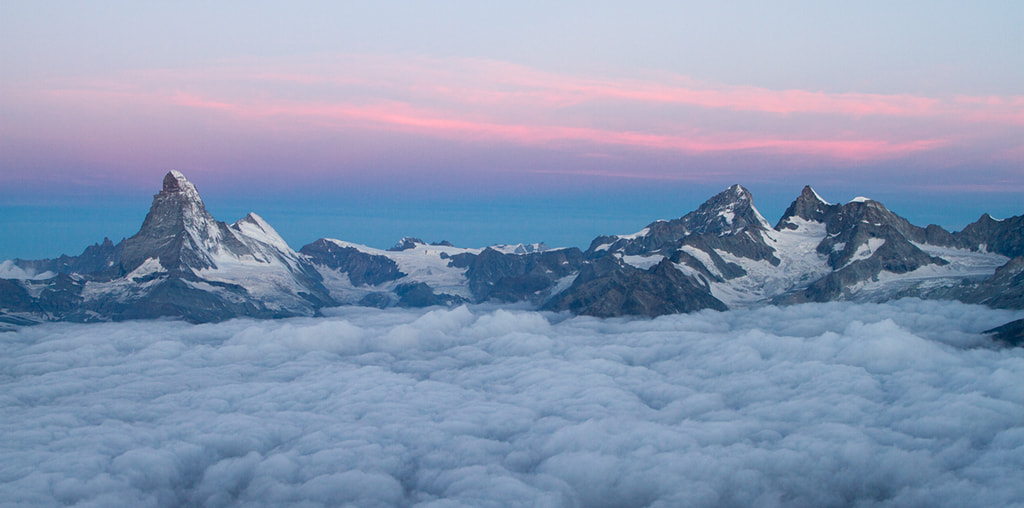 Photograph Firsts lights above the clouds by Gilles Monney on 500px