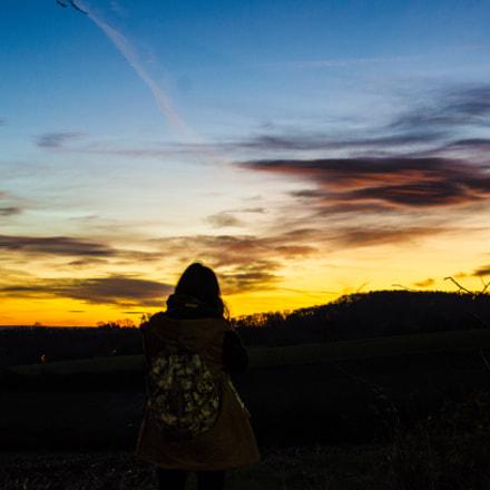 Beautiful Girl watching a beautiful sunrise