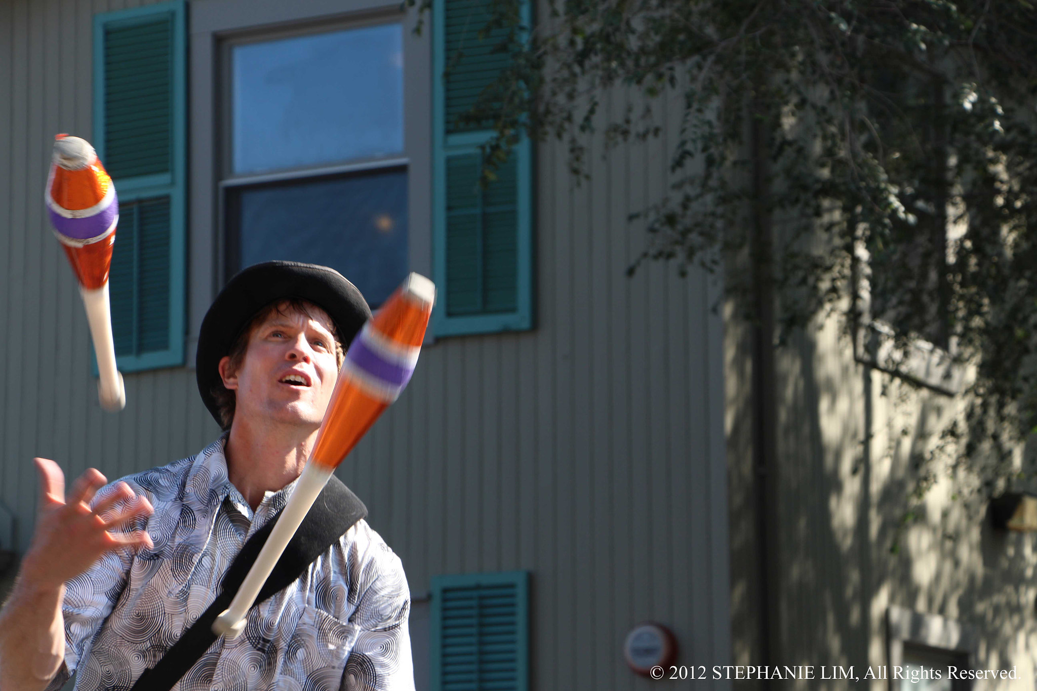 Photograph Busker juggler by Stephanie Lim on 500px