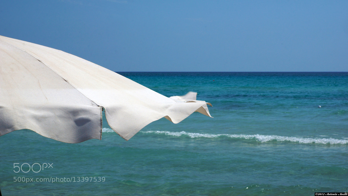Photograph Summer is ... the wind blowing on a beach umbrella by Antonio Anelli on 500px