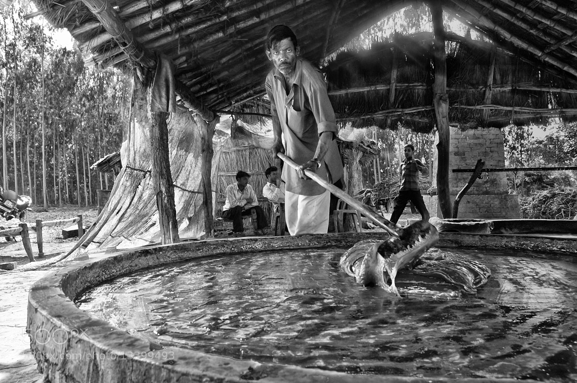 Photograph Tossing the concentrated sugar toffee - In black n white by Anoop Negi on 500px