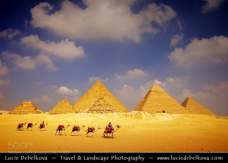 Photograph Egypt - Caravan at Pyramids of Giza – Famous landmark – One of Seven Wonders of the Ancient World by Lucie Debelkova -  Travel Photography - www.luciedebelkova.com on 500px