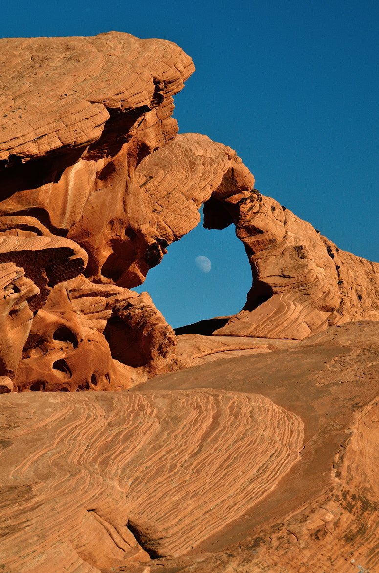 Photograph Moon Through Arch Rock by Rich Greene on 500px