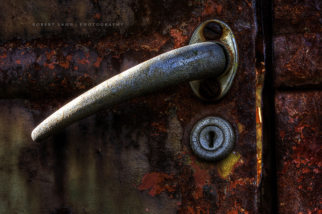 Photograph The door handle to a very old rusted out Chevrolet by Robert Lang on 500px