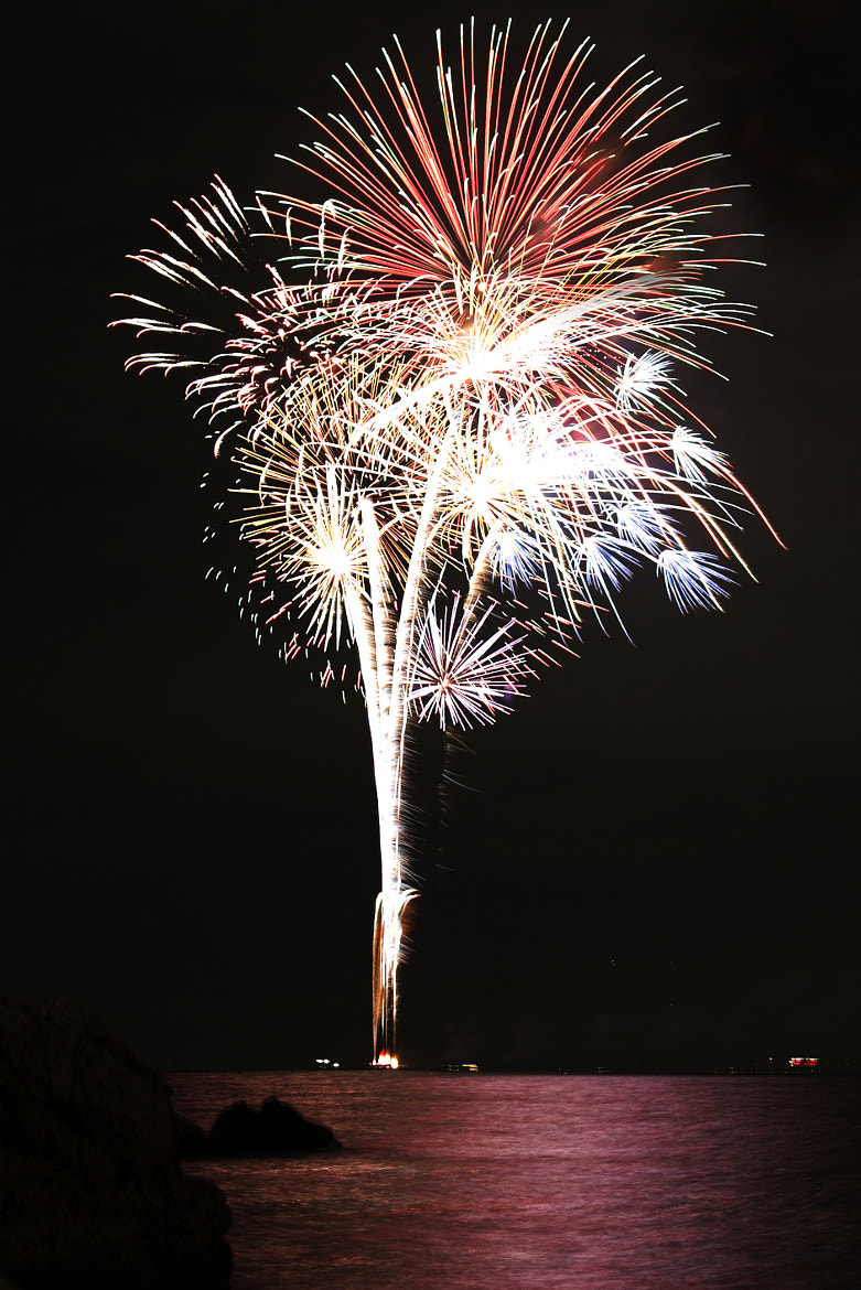 Photograph Fireworks over the ocean by Kenji Doi on 500px