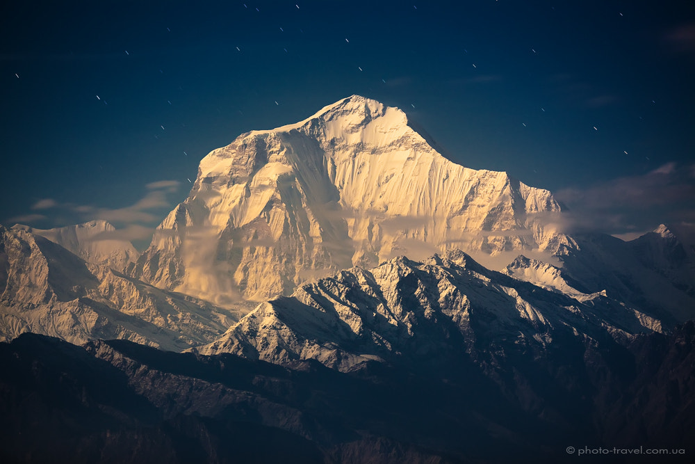 Photograph DHAULAGIRI (8167 m) in the Rays of Rising Full Moon by Anton Jankovoy on 500px