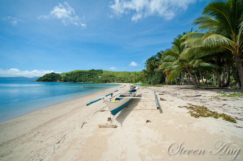 Photograph Outrigger Boat and the beach by Steven Ang on 500px