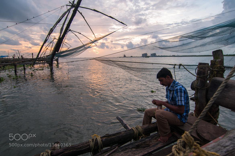 Photograph Fisherman, Fort Kochi by Sunil Thakkar on 500px