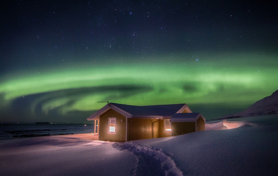 Ms. Aurora and the cottage by Dagur Jonsson on 500px.com