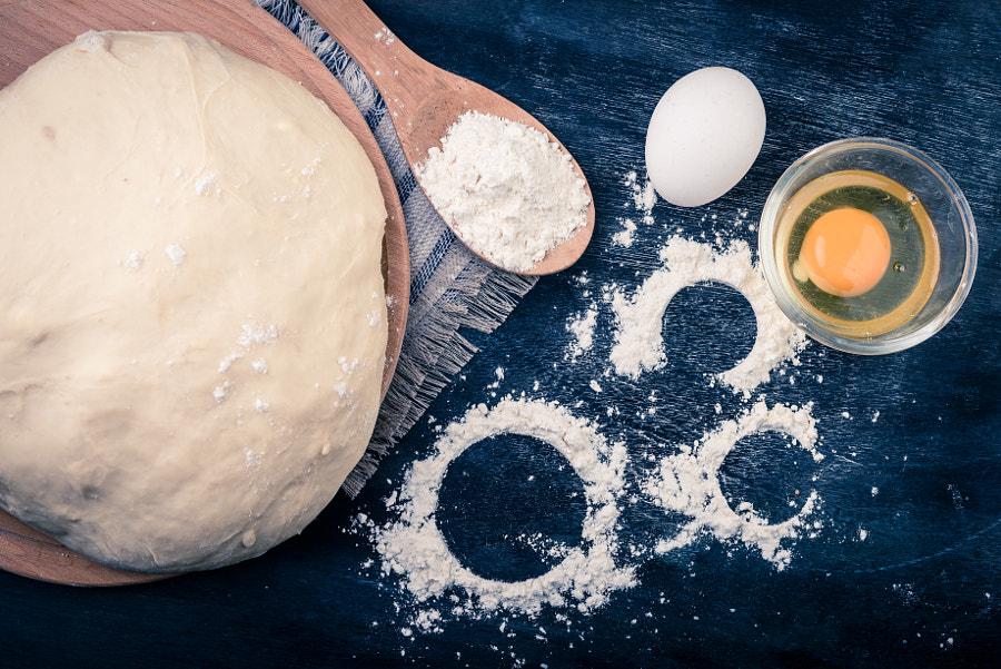Dough, egg, flour. Selective focus.  Rustic backgr by Elena Pavlovich on 500px.com