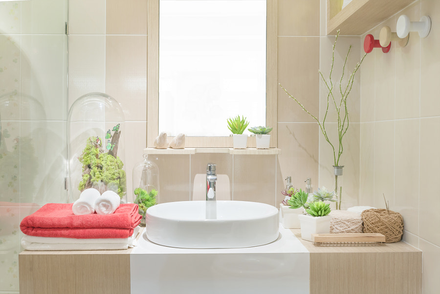 Washbasin with towel and decoration in bathroom by Prasit Rodphan on 500px.com