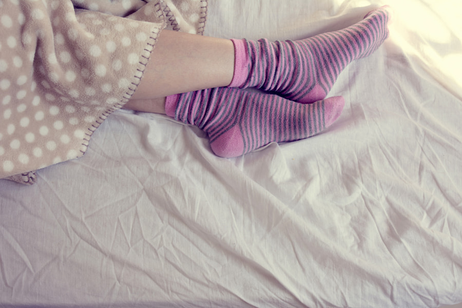 girl with pink striped socks, sleeping in bed by JAY  MID on 500px.com