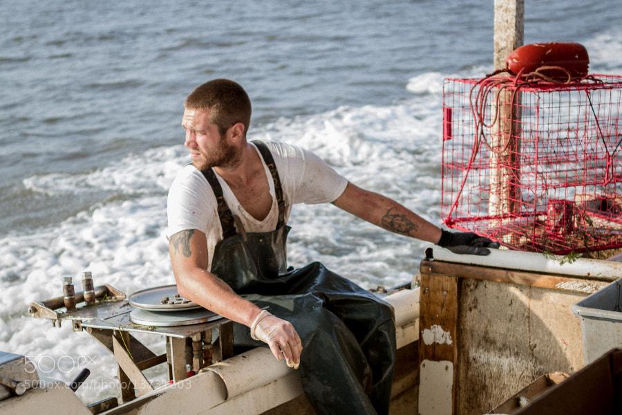 A crab fisherman takes a break between strings.