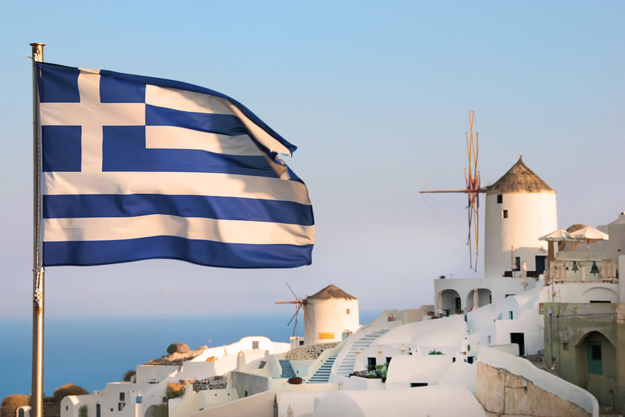 The Greek flag flying over Oia, Santorini.