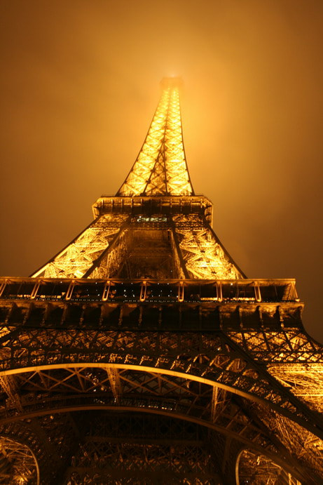 Photograph Golden Eiffel Tower in the haze by Danny Mac on 500px