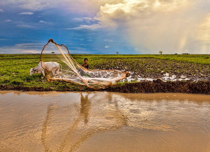 Photograph Young Cambodian Fisherman by Michel Latendresse on 500px