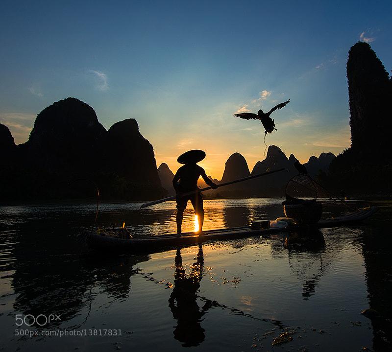 Photograph Fisherman at Li Jiang River by Jose Hamra on 500px