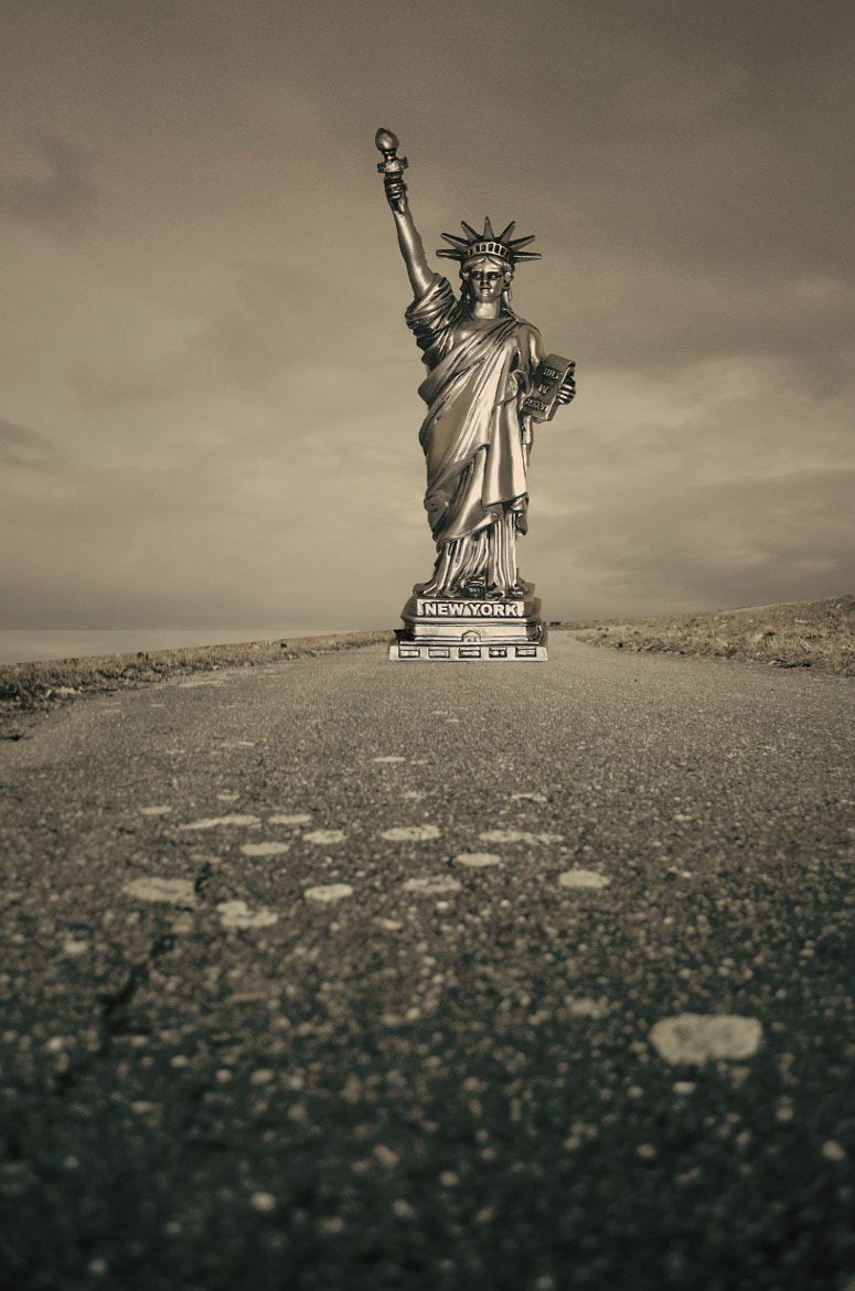 Photograph Statue in the middle of Road by Adrian Limani on 500px