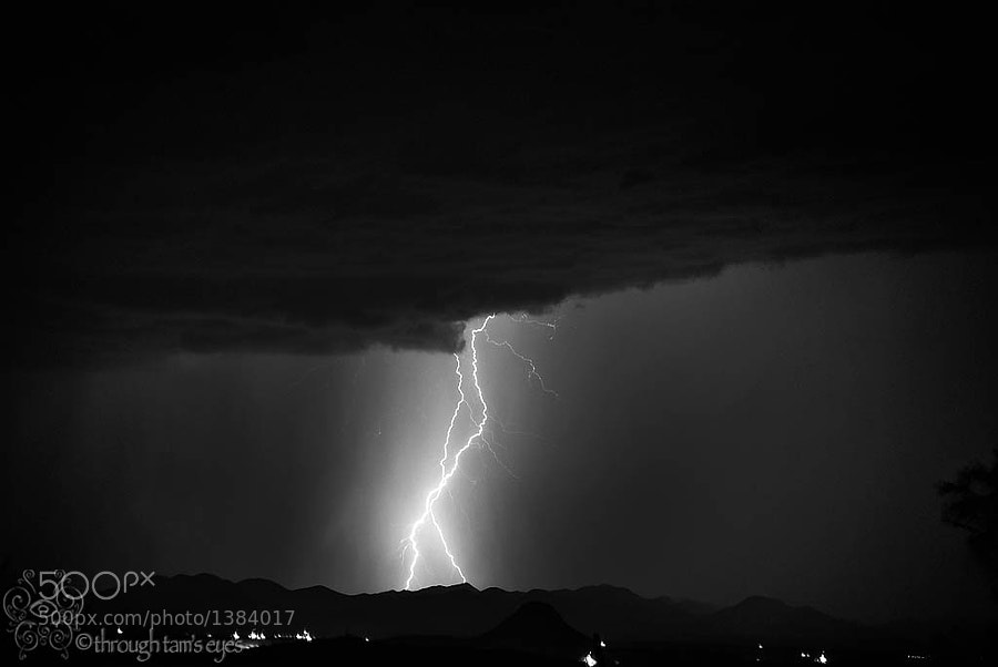 The southwest is known for the monsoon season and amazing lightning storms.  I captured this particular pair of strikes in a recent storm, from the roof of my porch.