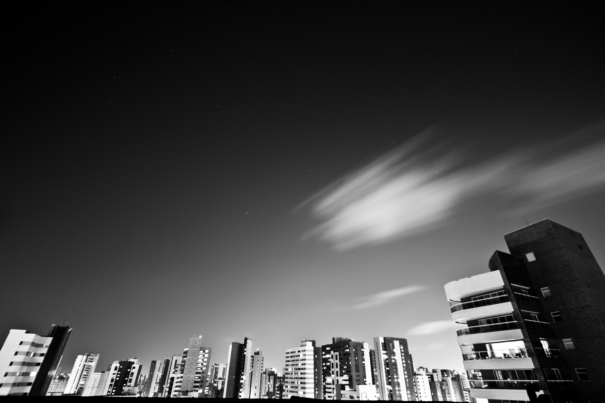 Photograph Black and White City Scape with Clouds and Stars  by A Melhor Imagem   on 500px