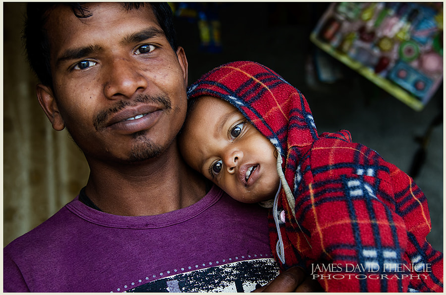 Faces of Nepal:   Hugging Dad