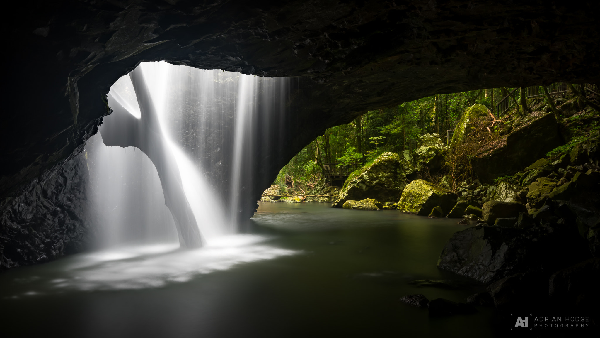 Waterfall running through the Natural Bridge, Springbrook National Park - Australia [2048x1152]