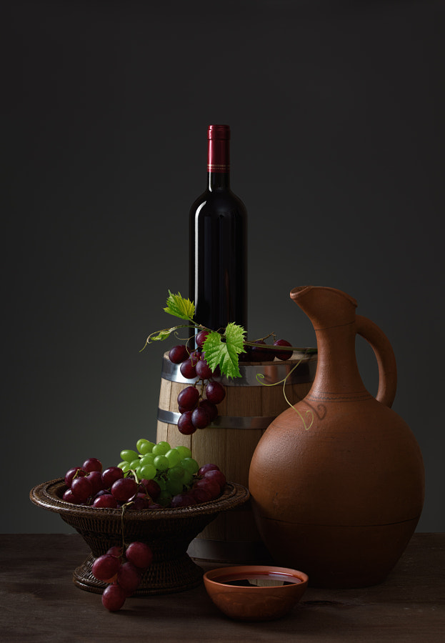 Bottle of red wine, grapes and wooden barrel by Mamuka Gotsiridze on 500px.com