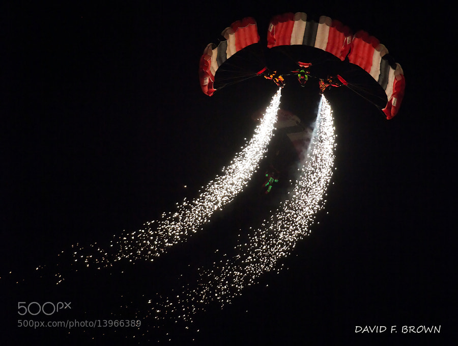 I usually shy away from night time air show photography.  I hung around on the ramp waiting for the fireworks and these guys floated by and I could not resist the urge to take a shot.