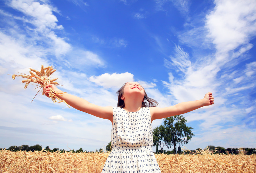Young girl have fun in the wheat field by Denys Kuvaiev on 500px.com