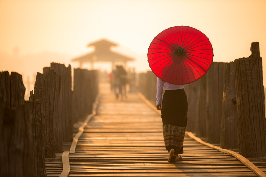 Unidentified Burmese woman walking on U Bein Bridge by Anusorn Sutapan on 500px.com