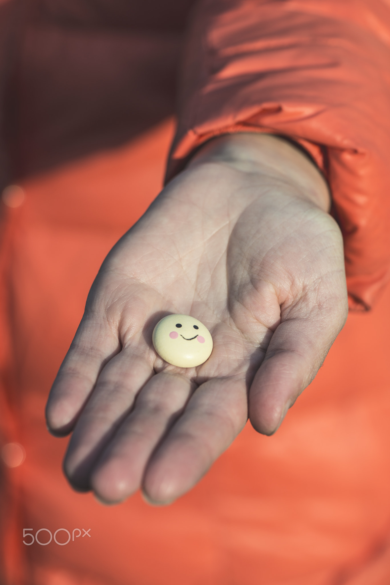 Smile icon in hand