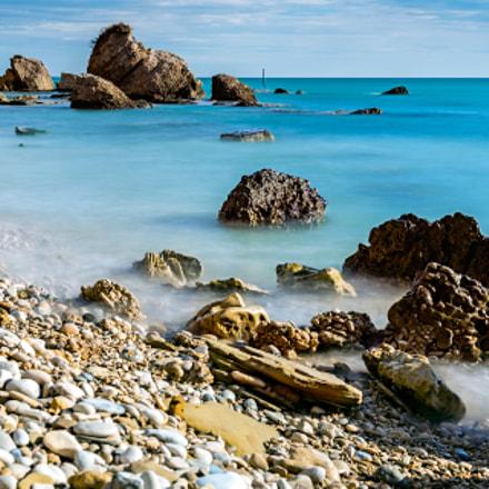 The sea caresses the rock