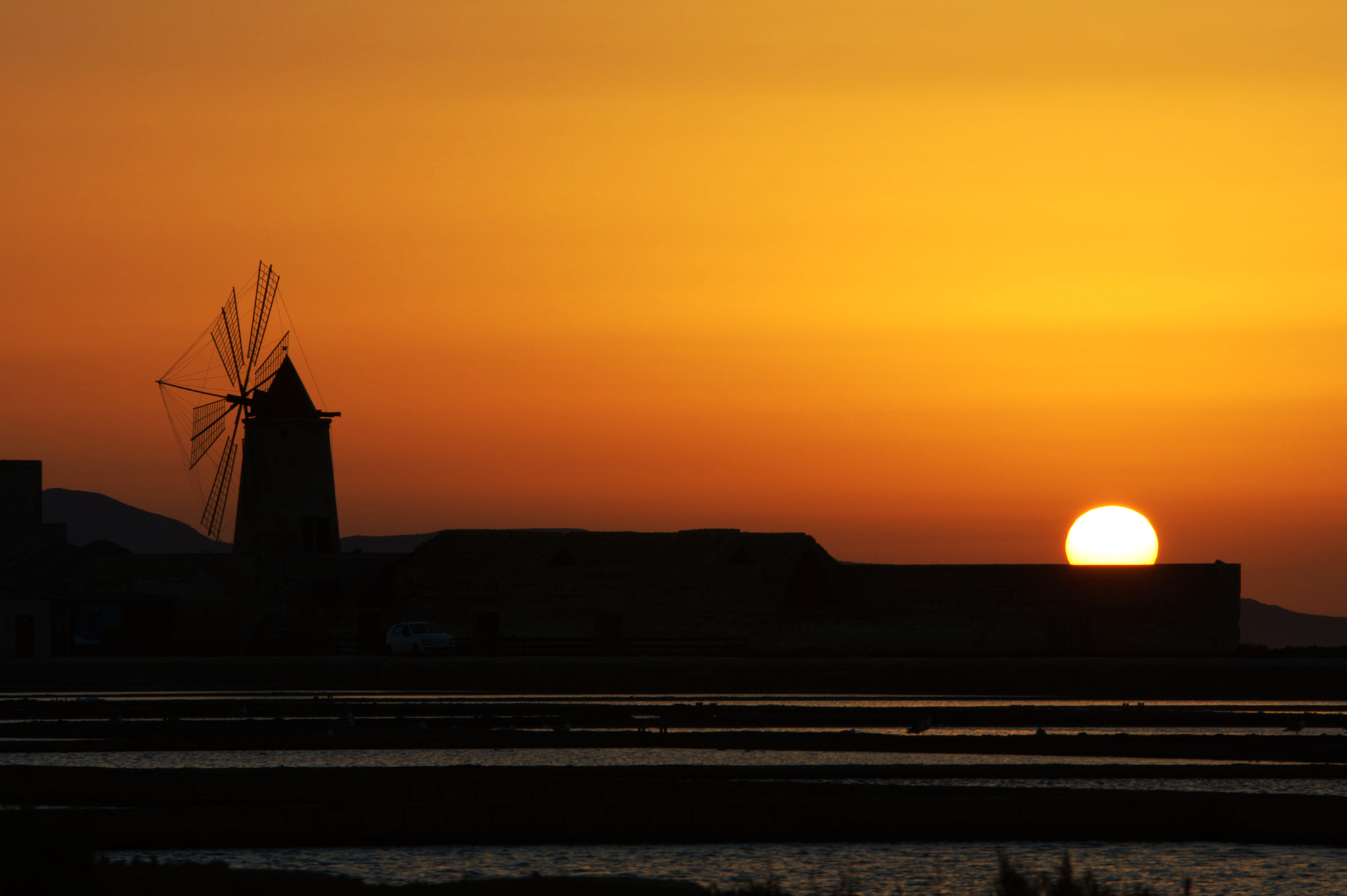 Photograph Sunset at the Salines of Trapani by Yulia R on 500px