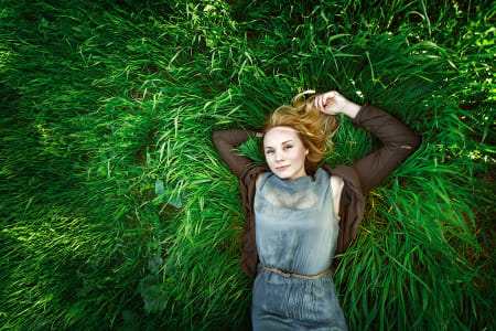 Beautiful meditative young woman lying in the grass. Summer, fre by Natta Summerky on 500px